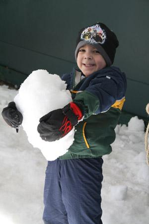 Boy holding snow